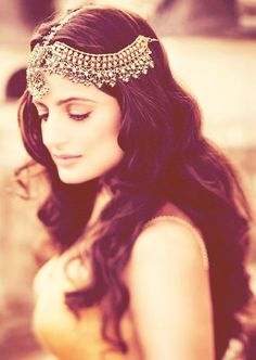 Long Wavy Indian Wedding Hairstyle. Digging the hair piece!