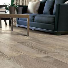 This living room floor is porcelain tile that looks like hardwood. The wood look tile is from the Rustic series and known as French Oak. Wood Grain Tile, Wood Tile Floors, Wood Laminate Flooring, Wood Look Tile Floor, Hardwood Floors, Ceramic Floor Tiles, Porcelain Tiles, Commercial Flooring, French Oak