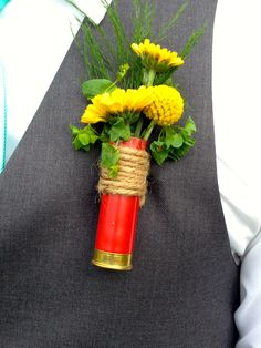 WEDDING FLOWER TUTORIALS: http://www.wedding-flowers-and-reception-ideas.com/make-your-own-wedding.html     Shot gun shell boutonnieres  yellow cushion mums, billy ball, feathery tree fern and bupleurum