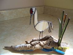 Stained glass white sandhill crane with cattails sitting atop driftwood. Hand cut glass, original design other colors and driftwood available@ artfire