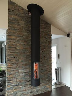 We've fallen in love with the suspended fireplace . Custom Fireplace, Home Fireplace, Fireplace Design, Fireplace Mantels, Fireplace Ideas, Pellet Fireplace, Suspended Fireplace, Hanging Fireplace, Freestanding Fireplace