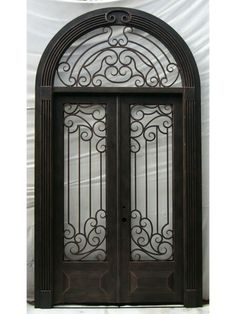Beautiful wrought iron door with an intricate transom and scrollwork. Wrought Iron Doors, Mirror, Beautiful, Home Decor, Iron Gates, Balcony, Art, Decoration Home, Room Decor