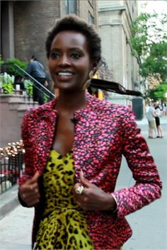 Ugandan model Kiara Kabukuru mixing prints- pink jacket and yellow leopard top.  Not sure who is the designer of this outfit. See Vogue Black for more styles, artists and stars:  http://www.vogue.it/en/vogue-black
