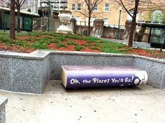 A bench by a bus stop in the Kansas City library district.