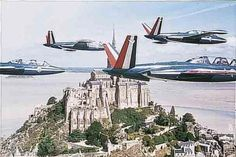 Fouga Magister trainers of Patrouille de France over Mont Saint-Michel. Fouga Magister de la patrouille de France
