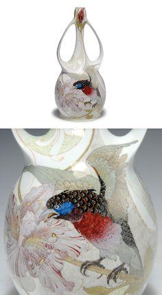Haagsche Plateelbakkerij ROZENBURG. Vase with handles, 1903. Decorated by Hendrikus Gerardus Antonius Huyvenaar. Eggshell porcelain, polychromatic glaze. Exotic angry bird with spread wings sitting on a twig of hibiscus. H. 26.7 cm.