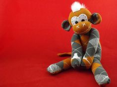 Handmade sock monkey : Blake  Longhorns  The by ChikiMonkeys