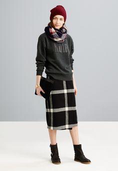 Madewell noir sweatshirt worn with plaid foldover skirt + shearling motorcycle boot.