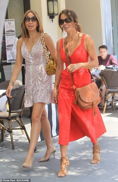 Brooke Burke highlights her trim waist in red midi dress as she opts to forgo a face mask after lunching with Isabel Madison | Daily Mail Online