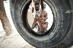 From Haiti, 2011 mission-Some of our volunteers decided to put up some tire swings for the boys at the orphanage near where we stayed. Smiles like that are the best kind of rewards :)