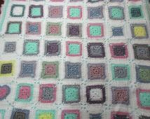 Lovely pastel crocheted baby rug. Wool.