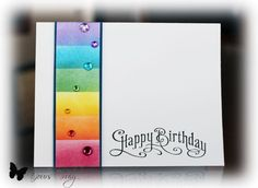 handmade birthday card ... luv the HAPPY BIRTHDAY STAMP ... column of sponged colors in order of the raibow ... like the same colored jewels and the black layering lines to define the soft shading of the rainbow column ...