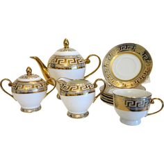 Russian porcelain tea set for four, ca. 1950 - Mid 20th Century porcelain teapot, sugar, creamer cups & saucers in white and gold, decorative golden Meander border. Tea Pot.