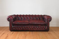 Vintage English Distressed Red Leather Tufted Chesterfield Sofa. $2,995.00, via Etsy.