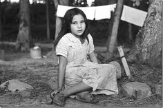 Eyes of the Great Depression 069. Indian girl, daughter of blueberry picker, near Little Fork, Minnesota    This photograph was taken by Russell Lee in May 1938.