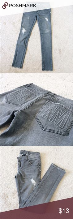 MTTB Grey Distressed Stretch Skinny Jeans Gently worn grey distressed skinny jeans from streetwear brand, Married To The Mob. Back Pockets are stitched and beveled with their initials. These jeans are super comfy and hug your body just right. They're made of 99% cotton with 1% spandex to give you ease of movement. Size 27. Married To The Mob Jeans Skinny
