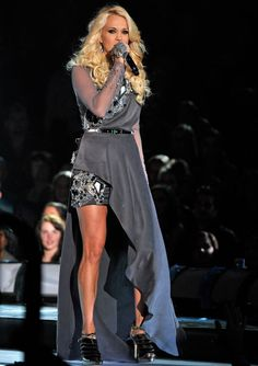 Carrie Underwood Vs. Carrie Underwood: Which of Her 12 CMA Looks Was the Best? | Hollywire