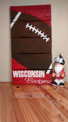 Hey, I found this really awesome Etsy listing at https://www.etsy.com/listing/261659832/wisconsin-badgers-football-pallet-art