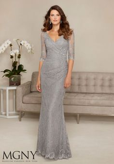 Evening Gowns and Mother of the Bride Dresses by MGNY Allover Lace with Beaded Appliqué Colors: Black/Nude, Silver.