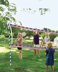 What a great idea! Attach red, white and blue bunting to your badminton net with velcro dots...decorate polls with ribbon.