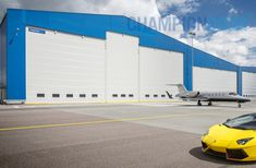 Champion Door has delivered business aircraft hangar doors all around the world. Business jet hangar doors with a stylish look gives a positive message. Jumbo Jet, Exterior Doors, Champion, Aircraft, Around The Worlds, Construction, Stylish, Business, Building