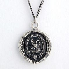 Selflessness Talisman Necklace. All of these necklaces were old 19th century wax seals and each have a particular meaning or symbolism - how awesome!