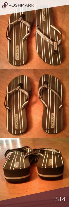 DKNY Sandals Worn Once Sz 8 DKNY black and white panic basket checkered strap thong Flip-flops with striped soles. Only worn once to the beach. Have too many sandals. Bundle up for a private offer! Womens Size 8. They can fit a 7.5 bc Im a 7-7.5 and they're not too crazy roomy on me but best fit for 7.5 to 8 Dkny Shoes Sandals