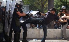 Riot police clash with protesters during the 24-hour nationwide general strike in Athens