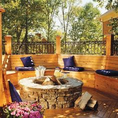 No ordinary wood deck here!  Notice the intricate railing design, built-in seating, stone fire pit and eye-catching accent color, all working together to create a warm and welcoming outdoor space.