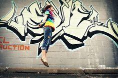 senior picture love e graffiti in the background
