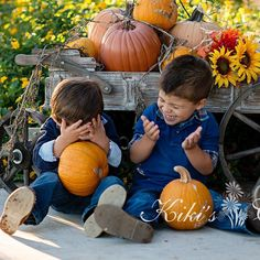 One of my all time fall favorites of these two. I can still hear their giggles. #fall #pumpkin #cousins #orange #nikon #wagon #denim #blue