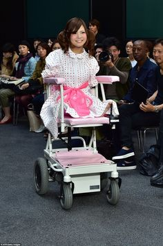 Disabled model Ami Sano sits on an electric wheelchair as she participates in Japanese designer Takafumi Tsuruta's show