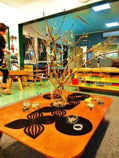 """When the children arrived back at Kindergarten after the term break they were greeted with the provocation of the beading tree. This was set up on the low table along with a wonderful array of small and large beads, pliable wire and ribbons"" - Mairtown Kindergarten ≈ ≈ http://pinterest.com/kinderooacademy/reggio-inspired/"
