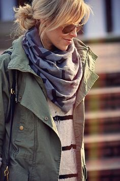 everything about this look.  patterned scarf, green jacket, striped sweater, aviators, bag, and messy up-do.  perfectly simple and awesome.