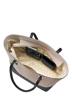 kate spade introduces the purse with a built in charger! What more could you ask for?!