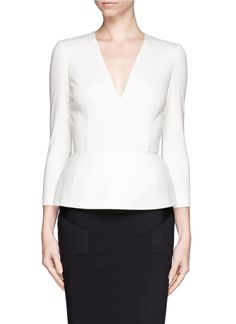 Bring prominence to a professional look with this primrose peplum top from Alexander McQueen. Lending ample structure to a fitted look, up-the-ante with this luxe piece crafted in wool-cashmere.