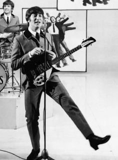 "John Lennon with his 1964 Rickenbacker 325 during a scene from the movie, ""A Hard Day's Night."""