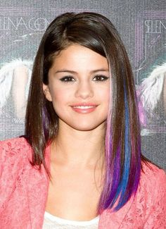 Selena Gomez in pink, red, and purple.  America's sweetheart does hair chalk!