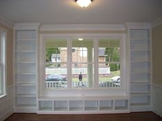 Built ins around window -- this is what I'm wanting to do around our french doors -- so the lower middle shelves would go UP! :)