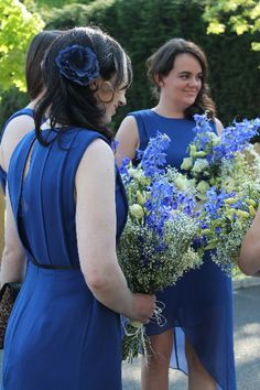 Bridesmaid's with blue and white delphinium bouquets.