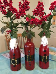 Wine bottle Santas. Red craft paint, black duct tape belt, buttons from the button box, cotton ball beards, yellow paint for the buckle and small bells. Great project with my granddaughter.