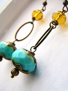 Turquoise and orange glass dangle earrings. $20.00, via Etsy.