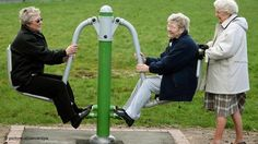 Seniors try out a piece of equipment at a pensioner playground in Manchester, UK