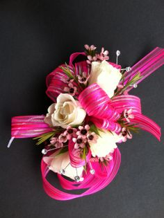 Sassy hot pink and white corsage.  Love the Waxflower accent.