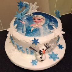Frozen (Elsa) 2nd Birthday Cake. Blue and White Frozen Cake With Fondant Olaf and Fondant Snowflakes.