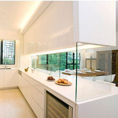semi open-plan kitchen design, aesthetically pleasing yet functional. Sliding glass panels can close up the kitchen to avoid smoke and smells from escaping in a small home Open Kitchen Layouts, Kitchen Layout Plans, Galley Kitchen Design, Open Plan Kitchen, Interior Design Kitchen, Kitchen Pass, Semi Open Kitchen Design, Kitchen Oven, Kitchen Counter Cabinet
