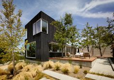 The new addition to this house in California is clad In Shou Sugi Ban siding