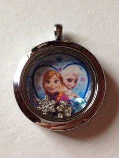 Disney's Frozen Floating Charm Locket--Elsa And Anna Heart by KeepCalmAndBeadIt on Etsy https://www.etsy.com/listing/214160005/disneys-frozen-floating-charm-locket