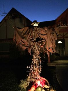 A scary scarecrow Halloween decoration up-cycled from dried yucca stems, tree limbs, old cloth and a pumpkin head.  Fun family project!