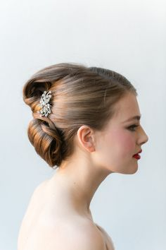 Brooch in Bridal Updo | photography by http://www.emiliajanephotography.com